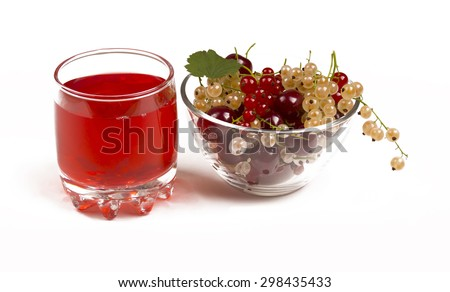 The berry juice in a glass. Berries in a glass bowl. The juice of the red and white currants. Cherry juice. - stock photo