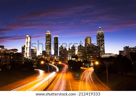 The best Atlanta Downtown overlook at dusk with traffic flow and blue sky red cloud/Atlanta downtown at dusk - stock photo
