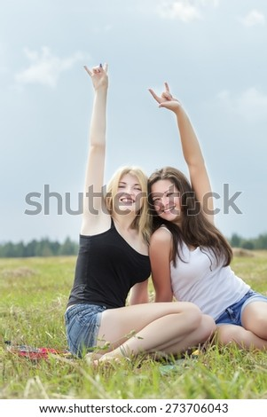 The best friends on summer vacations are showing signs of the horns  - stock photo