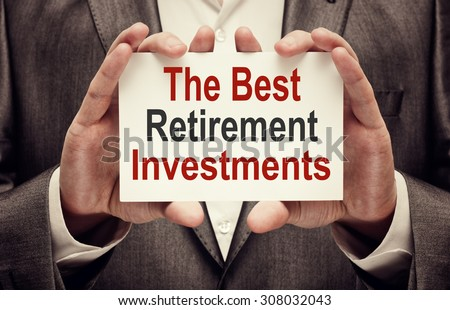 The Best Retirement Investments. Man holding a card with a message text written on it - stock photo