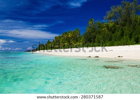 The best swimming beach with palm trees on tropical island Rarotonga, Cook Islands - stock photo