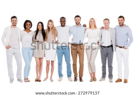 The best team ever. Full length of happy diverse group of people bonding to each other and smiling while standing against white background together - stock photo