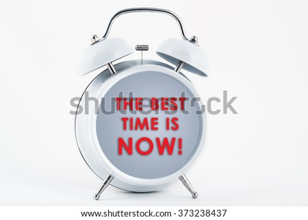 The best time is now alarm clock - stock photo