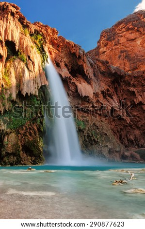 The best waterfalls in the United States in the Grand Canyon and flow with bright turquoise colored water. Havasu Falls, Supai, Arizona - stock photo