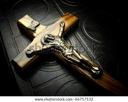 The bible and wooden crucifix - stock photo