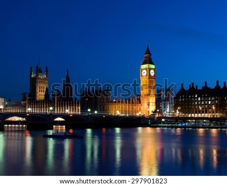 The Big Ben and Westminster by night with blue sky - stock photo