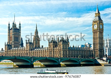 The Big Ben, the House of Parliament and the Westminster Bridge at night, London, UK. - stock photo