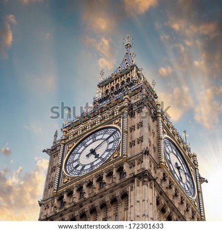 The Big Ben Tower Top in London against dramatic sky. - stock photo