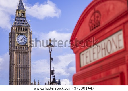 The Big Ben with iconic red British telephone box on a sunny afternoon with blue sky and clouds - London, UK - stock photo