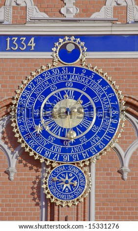 The big clock-calendar on the Blackhead's house in Riga. - stock photo