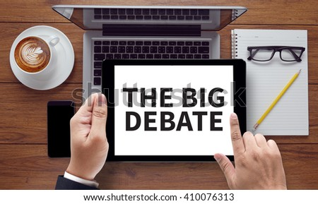 THE BIG DEBATE , on the tablet pc screen held by businessman hands - online, top view - stock photo