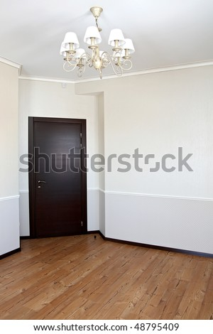 The big empty room with a parquet floor - stock photo