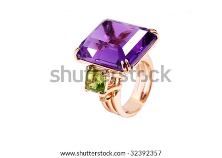 The big gold ring with an emerald and amethyst - stock photo