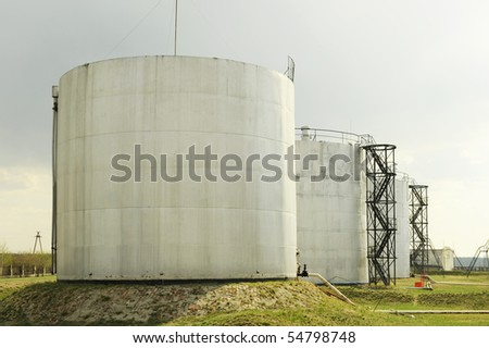 The big tanks with fuel on a petroleum storage depot - stock photo