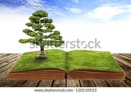 The big tree growth from a book - stock photo