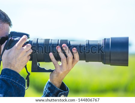The big zoom lens. - stock photo