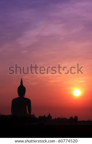 The Biggest Buddha Image In Thailand Under Sunrise - stock photo