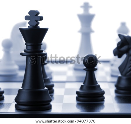 The black chess king.Blue toned. Selective focus - stock photo