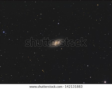 The Black Eye Galaxy (Messier 64) - A spiral galaxy about 17 million light years away in the constellation Coma Berenices - stock photo