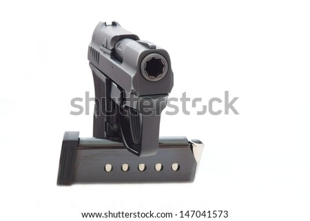 The black gun from metal and the holder with cartridges costs vertically on a white background - stock photo
