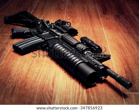 The Black Rifle with grenade launcher on the floor, selective focus - stock photo