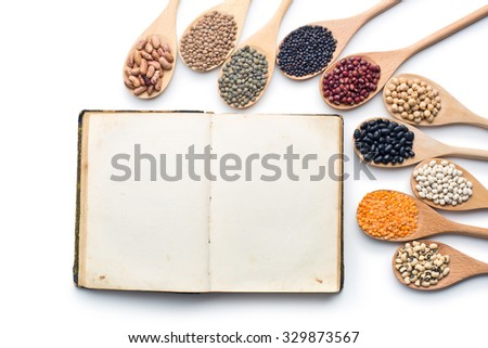 the blank cookbook and various legumes - stock photo