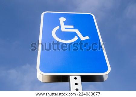 The blank handicap parking street sign. - stock photo