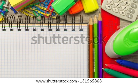 The  blank notebook on a desk with stationery - stock photo