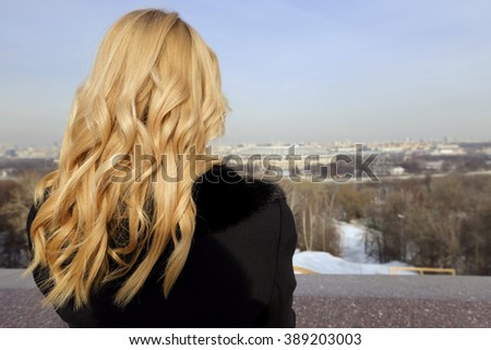 The blonde girl on the observation deck in Moscow in winter - stock photo