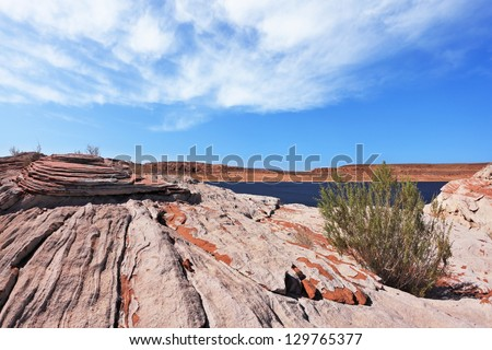 The blue and turquoise water in the desert rock. Bottling magnificent Lake Powell photographed by Fisheye lens - stock photo