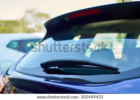 The blue car rear wipers - stock photo