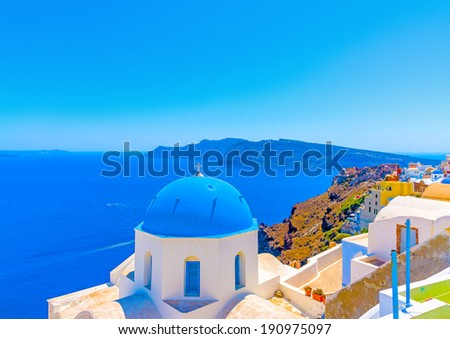 The blue colored dome of an old  traditional church in Oia the most beautiful village of Santorini island in Greece - stock photo