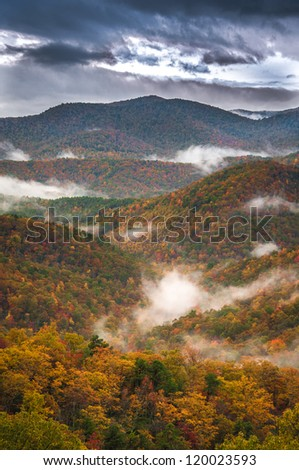 The Blue Ridge Parkway supplies a lifetime of beautiful scenery. In the Autumn months the color is ablaze with the magic of fall. - stock photo