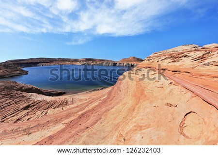 The blue water in the desert rock. Bottling magnificent Lake Powell photographed by Fisheye lens - stock photo