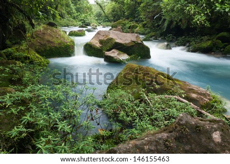 The blue waters of the Rio Celeste river near Bijagua, Costa Rica - stock photo
