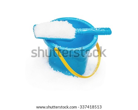 The blue yellow bucket and shovel which are filled up with snow, covered snow,  isolated on the white - stock photo