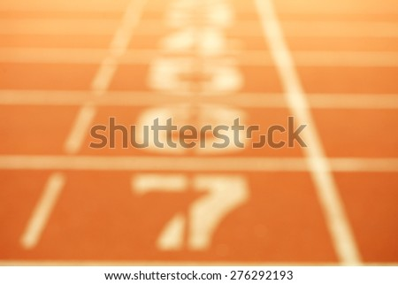 The blurry focus of running race track number screen on ground surface represent the sport concept related idea. - stock photo