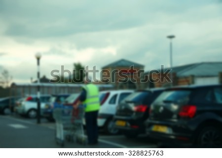 The blurry focus scene of supermarket car park scene represent the shopping and supermarket concept related idea. - stock photo