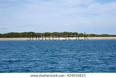The boardwalk and beach at John D. MacArthur State Park with offshore underwater reef on Singer Island, Florida, a popular tourist attraction for safe swimming and snorkeling. - stock photo