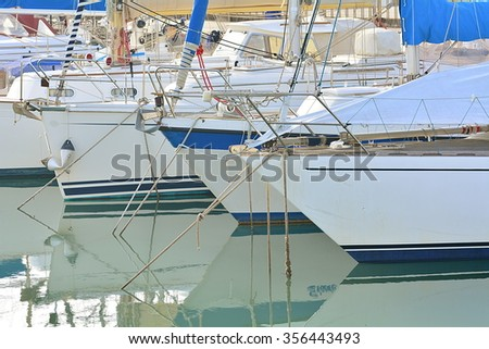 The boats and the yacht on the port. - stock photo
