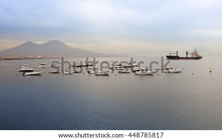The boats in a bay of Naples, Italy, in the foggy morning.