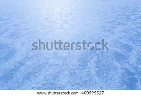 The Bonneville Salt Flats in Utah looking blue in the evening - stock photo