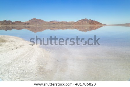 The Bonneville Salt Flats in Utah with beautiful reflection - stock photo