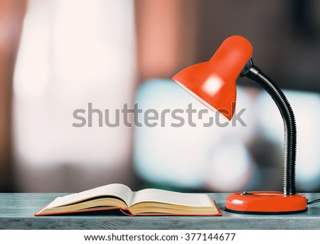 The book and lamp - stock photo