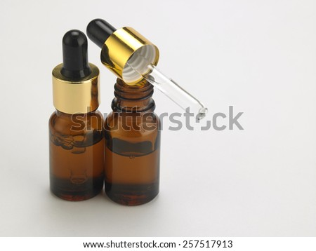the bottle of the essential oil - stock photo