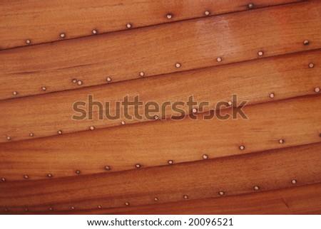 The Bottom of the Hand-Made Teak Sailing Boat - stock photo
