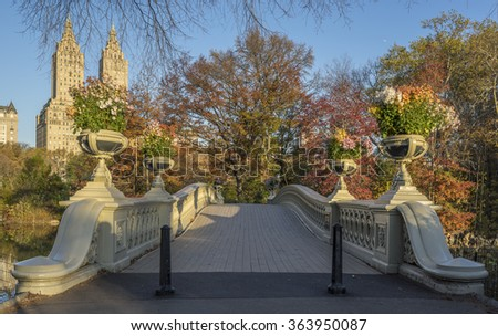 The Bow Bridge  is a cast iron bridge located in Central Park, New York City, crossing over The Lake in autumn - stock photo