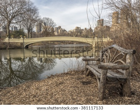 The Bow Bridge  is a cast iron bridge located in Central Park, New York City, crossing over The Lake  early in the morning in the winter - stock photo
