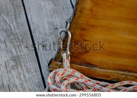 the bow of a Hand crafted wooden rowboat laying on a deck upside down at dusk - stock photo