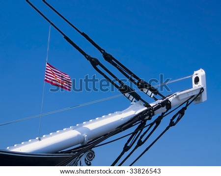The bow of the U.S.S. Constitution with the flag of the American Revolution at Boston Harbor, Massachusetts - stock photo